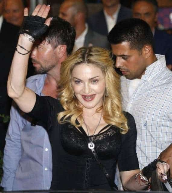 Awkward Grill Girl Madonna Looks Funny Wearing Golden Braces -04